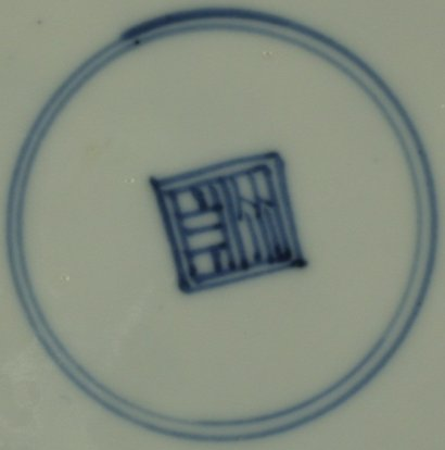 2010151 Square shop mark in a double circle, underglaze blue.
