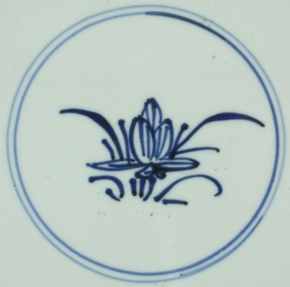 2011340 Symbol mark: Lotus. Symbol of purity and one of the eight Buddhist Emblems, in a double circle, underglaze blue.